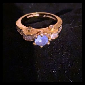 Fashion ring with blue stone and clear stones